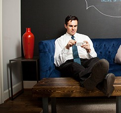 man on sofa with phone